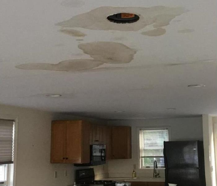 Water Damaged Ceiling Before