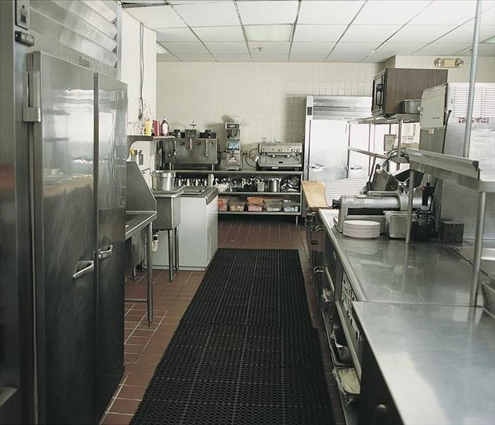Commercial Commercial Water Damage from a Leaky Refrigerator in Your Amherst Deli