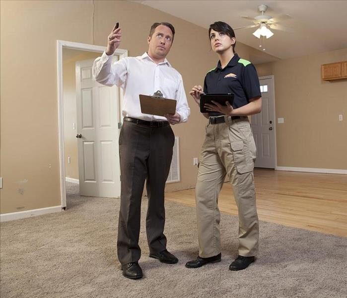 Man consulting with SERVPRO technician
