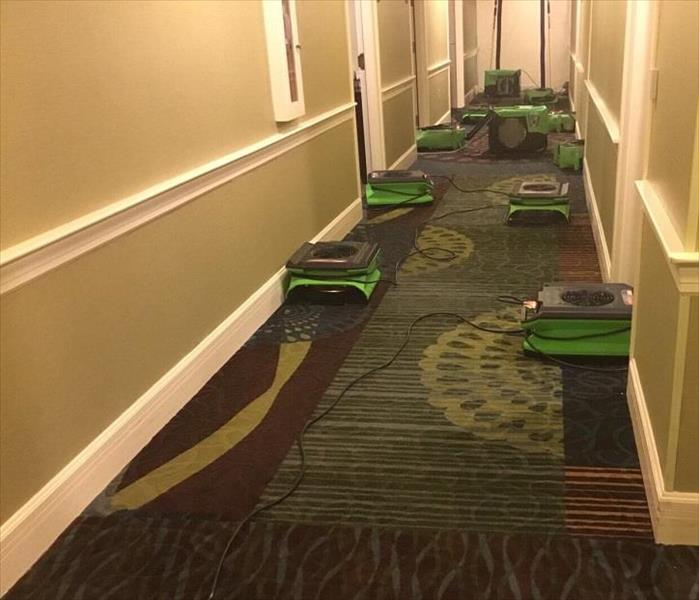 SERVPRO drying equipmen being used in long hallway